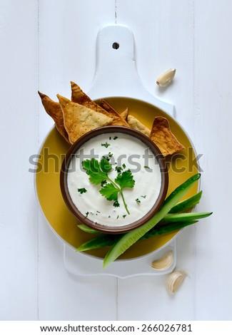 Traditional greek refreshing dip made of yogurt, cucumber and various herbs, top view - stock photo