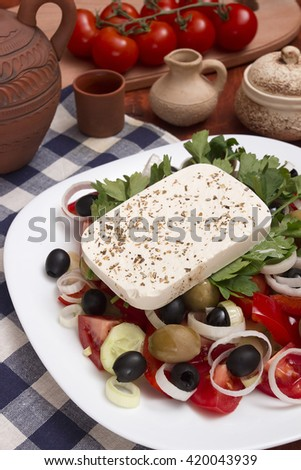 Traditional Greek salad on the white plate