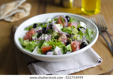 Traditional Greek salad with feta, olives and vegetables - stock photo