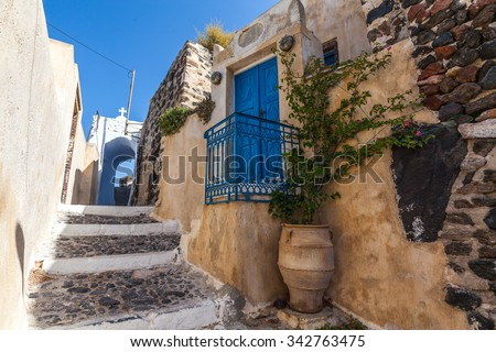 Traditional greek street in Pyrgos village, Santorini, Greece - stock photo