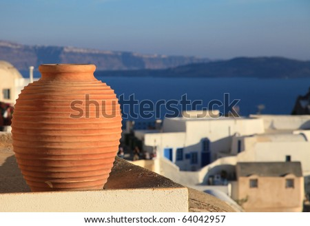 Traditional Greek vase with spectacular caldera view on the background (Oia, Santorini, Greece) - stock photo