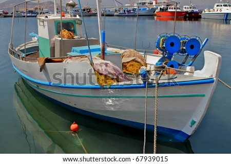Traditional Greek village fishing boat - stock photo