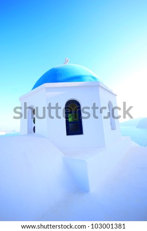 Traditional Greek white church arch  in village Oia of Cyclades Island Santorini Greece - stock photo