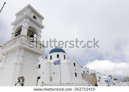 Traditional Greek white church arch with cross and bells in Santorini Greece - stock photo