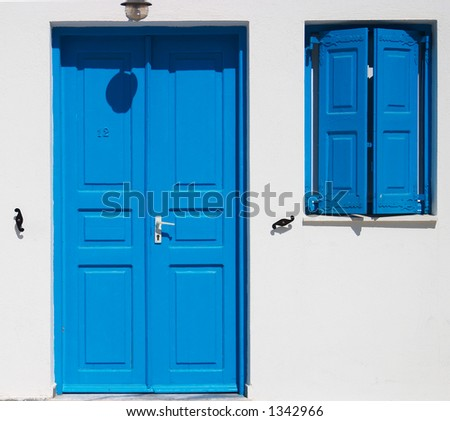 Traditional greek window and door, Santorini, Greece - stock photo