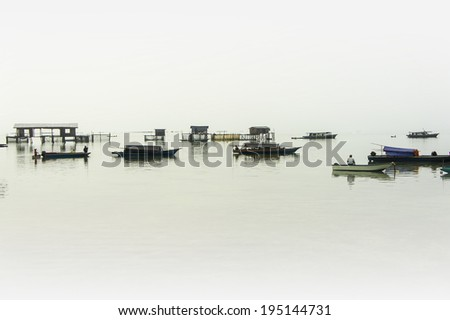traditional gypsy village on fog background - stock photo