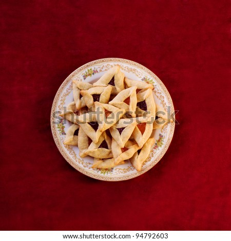Traditional Hamantaschen cookies for the Jewish festival of Purim - stock photo