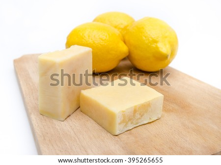 Traditional hand made lemon scented and extract soap on a wooden