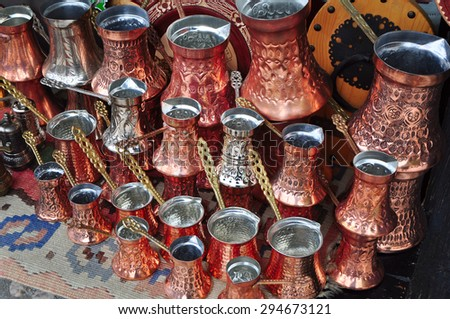 Traditional handcrafted copper coffee pots in souvenir shops in Sarajevo. Bosnia - stock photo