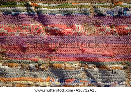 Traditional Handmade old colored carpet withgrains of sand - stock photo