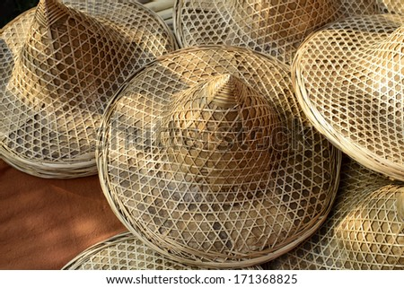 Traditional hat made of bamboo wood and dry leaves - stock photo