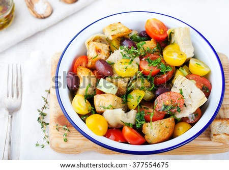 Traditional healthy Panzanella salad with fresh tomatoes and crispy bread Top view