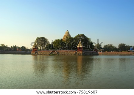 Traditional Hindu temple on lake in the city center, South India, Kerala, Madurai - stock photo