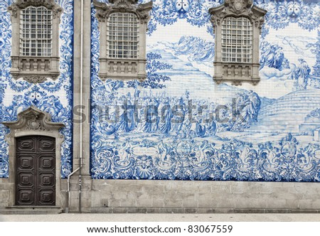 Traditional historic facade in Porto decorated with blue hand painted tin-glazed tiles, Oporto, Portugal - stock photo