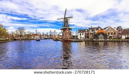Traditional Holland - vamals and windmills (Haarlem) - stock photo