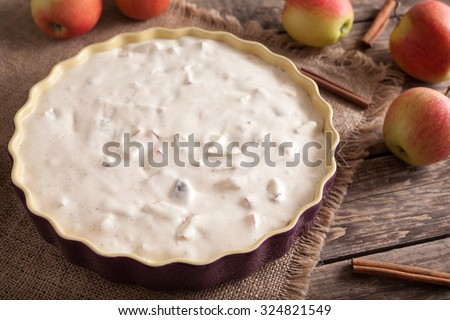 Traditional homemade apple pie with cinnamon preparation recipe on vintage wooden background. Rustic style and natural light. - stock photo