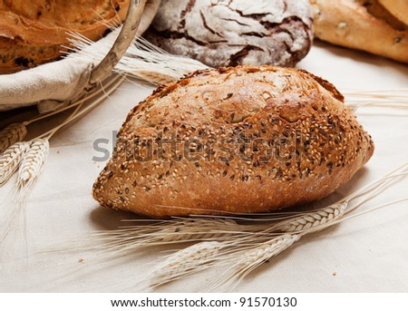 Traditional homemade bread on a table with cones - stock photo