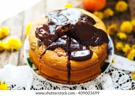 Traditional homemade chocolate cake. Rustic style and natural light. Chocolate Mud Cake  on White table. Piece of chocolate cake with icing. Vanilla Cake with Chocolate Glaze. - stock photo