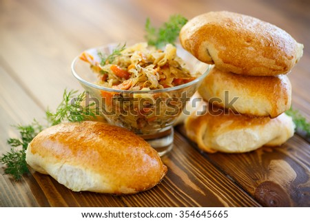 Traditional homemade pies with cabbage and sauerkraut  - stock photo