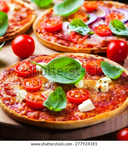 Traditional homemade pizza with tomato and cheese - stock photo