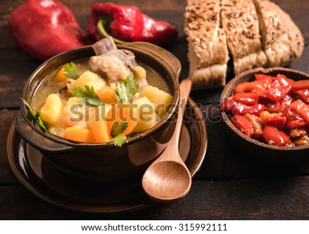 Traditional homemade stew soup with vegetables and meat,selective focus  - stock photo
