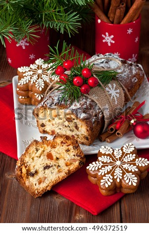 Traditional homemade stollen with dried fruits and nuts. Christmas cake