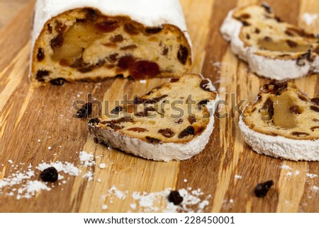 Traditional homemade stollen with dried fruits and nuts. Selective focus. - stock photo