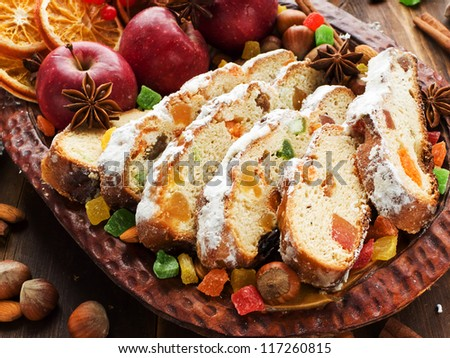 Traditional homemade stollen with dried fruits and nuts. Shallow dof. - stock photo