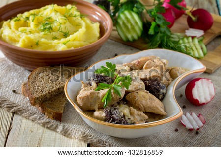Traditional hot ragout with meat and prunes stewed in sour cream sauce for healthy eating. - stock photo