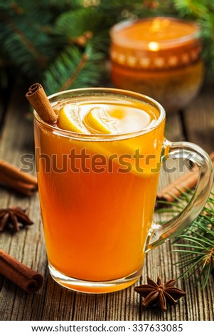 Traditional hot toddy winter drink with spices recipe. Healthy organic homemade holiday celebration beverage in glass. Vintage wooden background. Rustic style. - stock photo