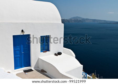 Traditional house at Oia village of Santorini island in Greece - stock photo
