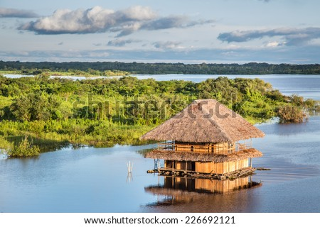 Traditional house on the Amazon river in Iquitos, Loreto, Peru - stock photo