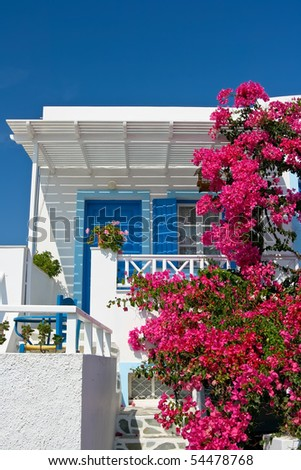 Traditional house with Bougainvillea in Santorini, Greece - stock photo
