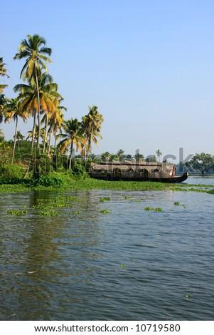 Traditional houseboat cruise through the backwaters, kerala, india - stock photo