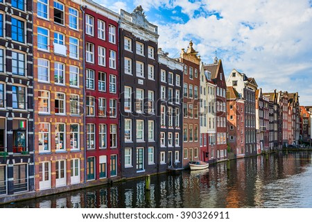 Traditional houses on canal in Amsterdam, Netherlands. - stock photo