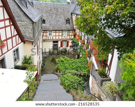 traditional houses on narrow street in Beilstein village, Moselle region, Germany - stock photo