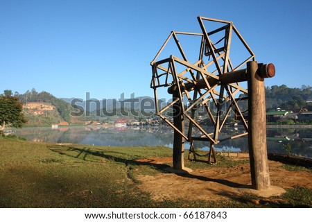traditional huge wooden swing of Northern Thailand. - stock photo