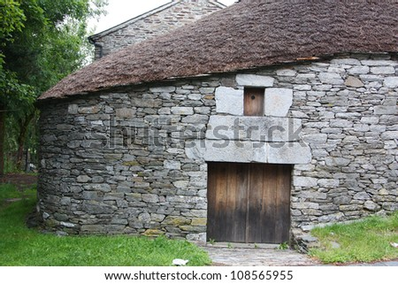 traditional hut at o cebreiro - stock photo