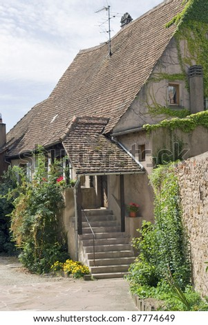 traditional idyllic house in Mittelbergheim, a village of a region in France named Alsace - stock photo