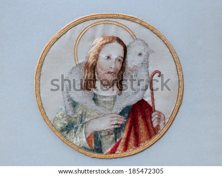 Traditional image of Jesus Christ as the Good Shepherd, with a sheep on his shoulders, hand embroidered in former Art Needlework Department of Saint Benedict's Monastery, St. Joseph, Minnesota - stock photo