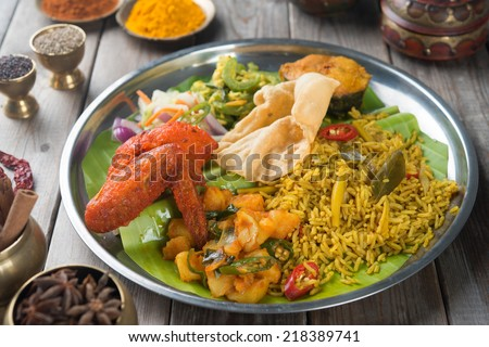 Traditional Indian biryani rice on wooden dining table. - stock photo