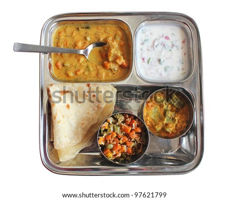 Traditional Indian bread chapati with curries, raitha and salad isolated on white