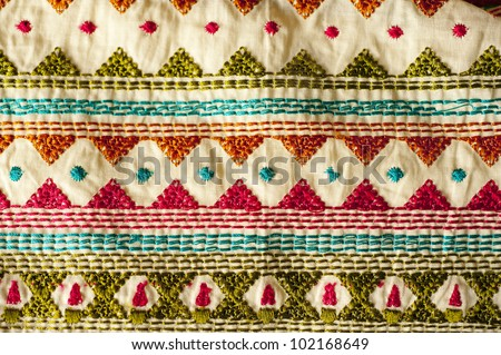 Traditional Indian fabric with colorful embroidery - stock photo