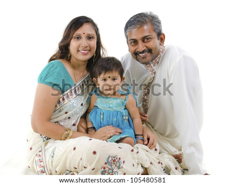 Traditional Indian family with one child sitting on white background