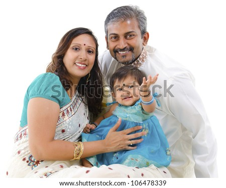 Traditional Indian family with one child sitting on white background - stock photo