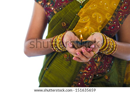 traditional indian female with oil lamp during the celebration of deepawali or diwali on white background - stock photo