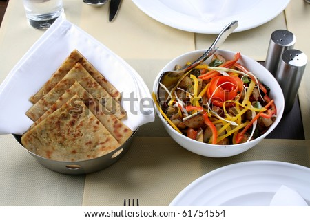 traditional indian food of stuffed paranthas and mix vegetables - stock photo
