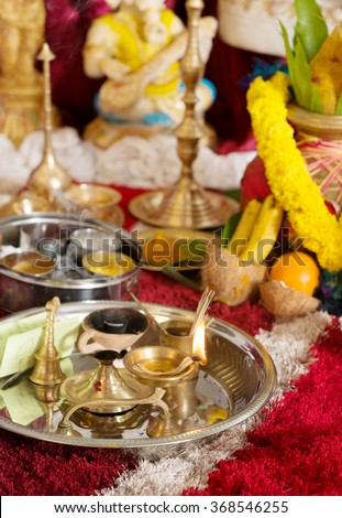 Traditional Indian Hindu religious praying items in ear piercing ceremony for children. Focus on the oil lamp. India special rituals events. - stock photo