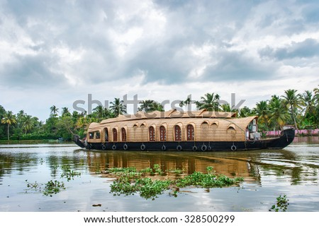 Traditional Indian houseboat near Alleppey  on Kerala backwaters, India - stock photo