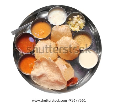Traditional indian lunch food and meals with rice, phulka, puri, curries and sweets isolated on white - stock photo